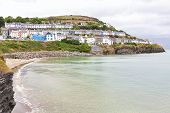 Rows Of Colourful Hilltop Houses Overlooking The Pretty Harbour Of New Quay In Cardiganshir In West  poster