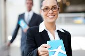 stock photo of over counter  - businesswoman handing over air ticket at check in counter - JPG