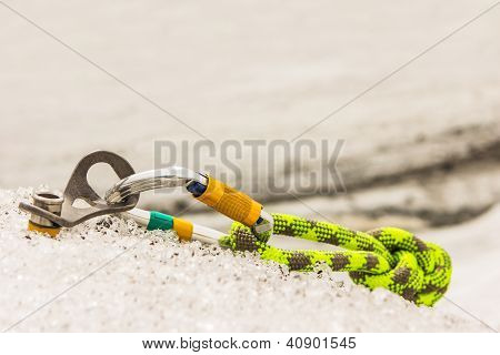 Carbine And Hook With Rope In Ice.
