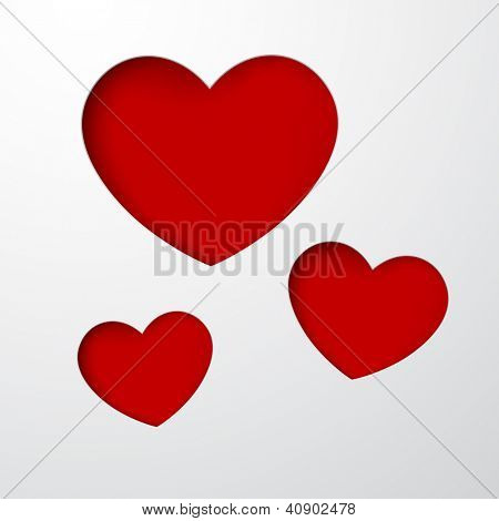 Vector abstract background composed of red notched out paper hearts. Eps10.