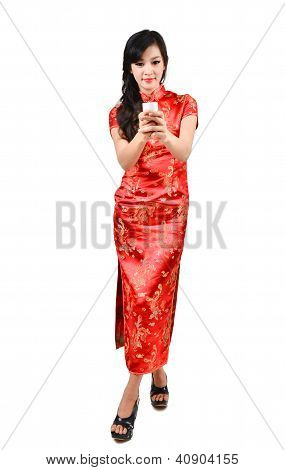 Pretty Women With Chinese Traditional Dress Cheongsam And Drinking Tea