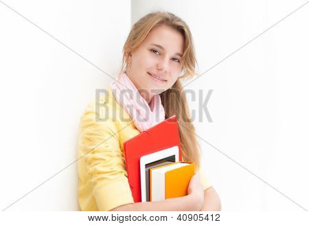 Young pretty female student on white background.