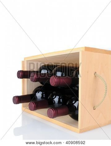 Closeup of six Cabernet Sauvignon wine bottles in a wooden crate laying on its side. Vertical format isolated on white with reflection.