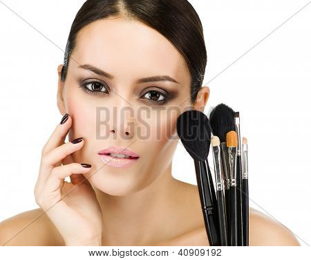 portrait of attractive  caucasian  woman brunette isolated on white studio shot face closeu? brushes makup