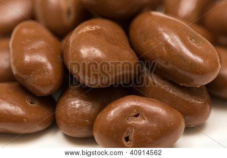 Pile Of Chocolate Raisins On White