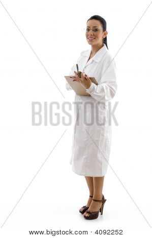 Side View Of Doctor With Writing Pad On White Background