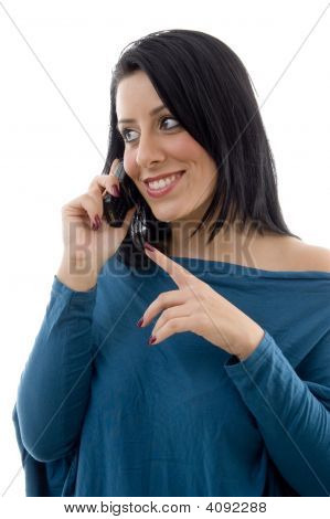 Front View Of Smiling Female Talking On Mobile On White Background