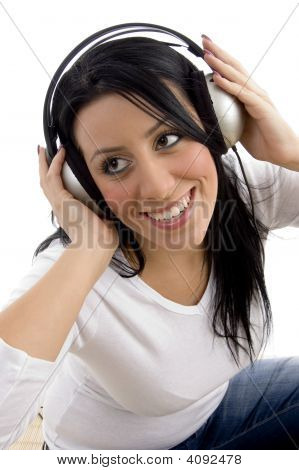 Top View Of Smiling Woman Posing With Headphone