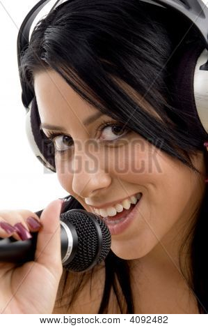 Close Up Of Smiling Female With Headphone And Microphone