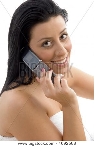 Side View Of Smiling Woman Talking On Cell Phone