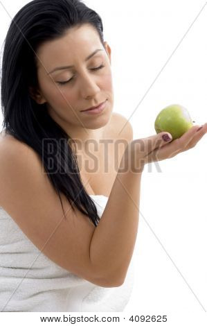 Side View Of Woman Posing With Apple