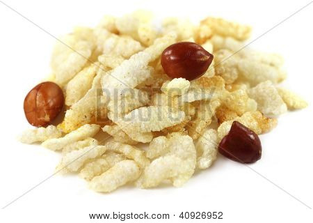Fried flattened rice with peanuts over white background