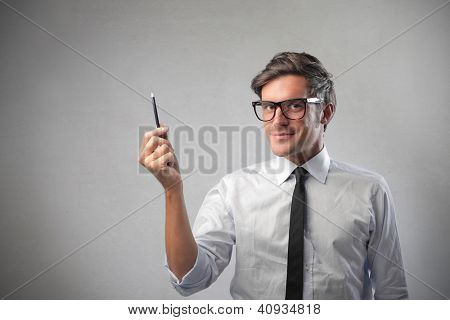 Office worker indicating something with a pen