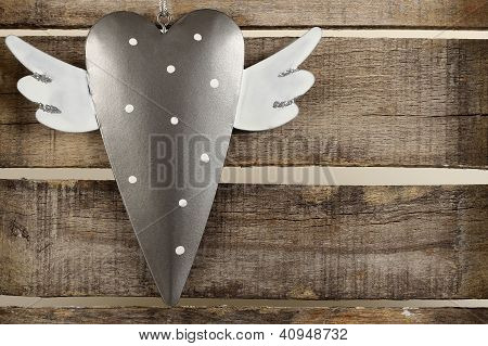 Tin Heart On Old Wooden Background