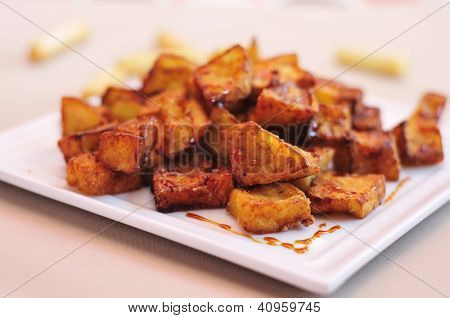 closeup of a plate with spanish berenjenas con miel de cana, fried eggplants with molasses, served as tapas