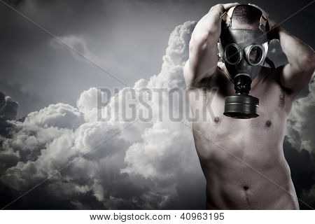 pollution concept: portrait of nude man in a gas mask