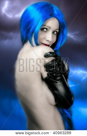 vogue style portrait of beautiful delicate woman with blue hair over electric storm