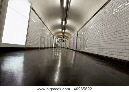 Old underground tunnel illuminated with neon