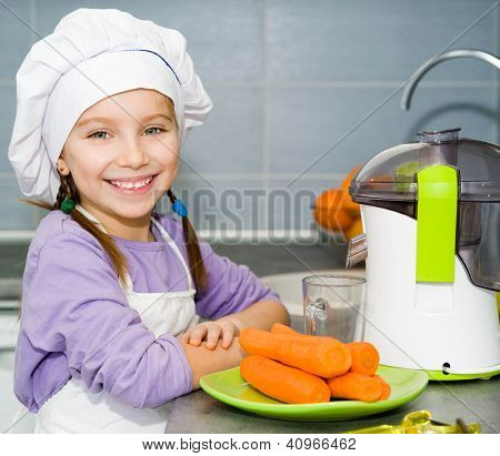 girl  making fresh and healthy juice with a juice extractor
