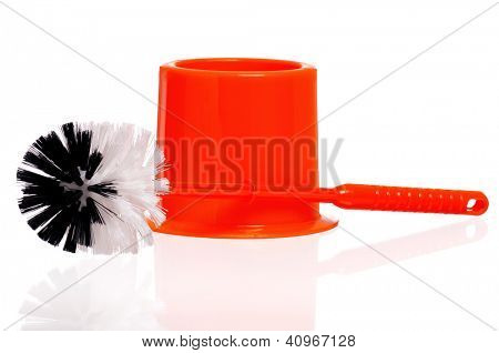 Plastic orange toilet brush isolated on white background