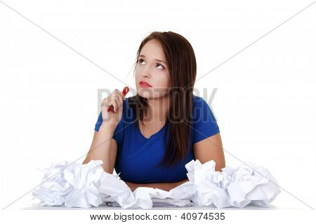 Young student woman thinking at the desk, isolated on white