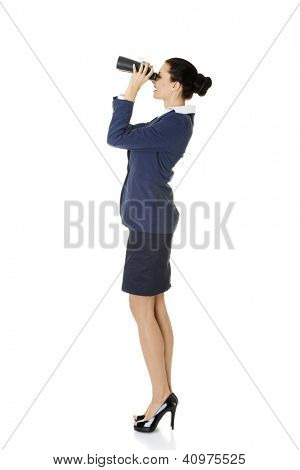 Businesswoman with binoculars searching for business oportunity in the future. Isolated on white background.
