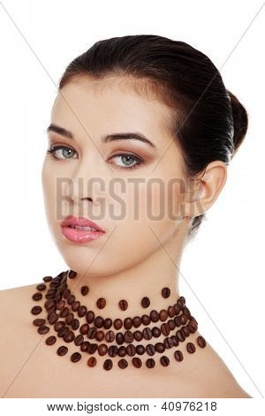 Beautiful elegant young woman with necklace made frome coffee beans, isolated on white