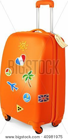 Orange travelling baggage suitcase with stickers