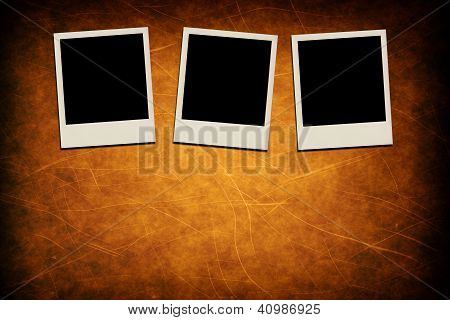 Blank Instant Photo Frames On Grunge Brown Background