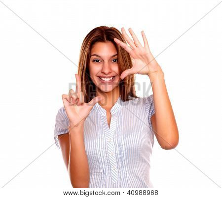 Pretty Young Woman Making Frame With Her Fingers