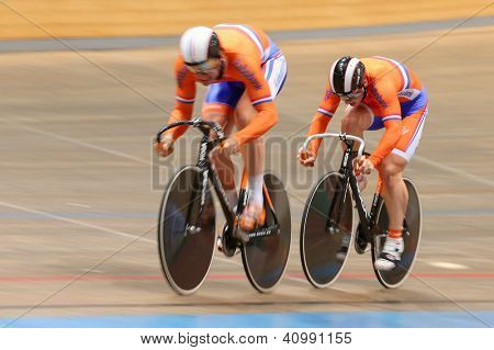 VIENNA,  AUSTRIA - SEPTEMBER 27  Hugo Haag and Jeffrey Hoogland (Netherlands) compete in the men's team sprint event of an indoor cycling meeting on September 27, 2012 in Vienna, Austria.