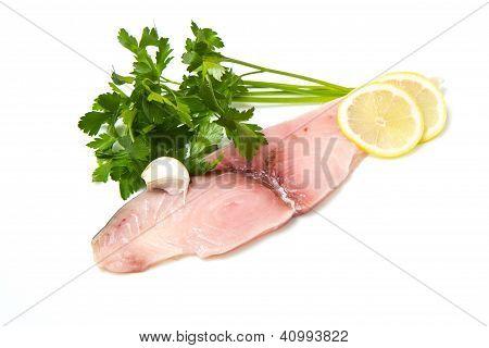Swordfish With Lemon And Parsley On White