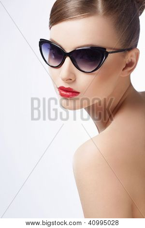Attractive girl in sunglasses on a white background