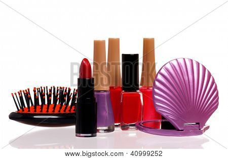 Set of cosmetics - nail polish, small mirror, comb and lipstick isolated on white background