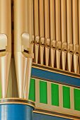 picture of pipe organ  - A fragment of antique church organ pipes - JPG