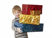 stock photo of little boy  - The smiling boy bears gifts - JPG