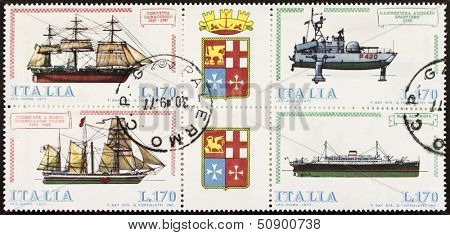 ITALY �¢?? CIRCA 1977: a block of four stamps printed in Italy shows illustrations of  four Italian old ships and coats of arms of Italian Royal Navy. Italy, circa 1977