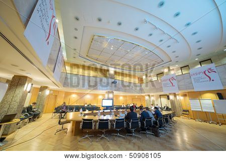 MOSCOW - APR 17: People sitting on 9th Congress IPO in Moscow Stock Exchange on April 17, 2013 in Moscow, Russia.