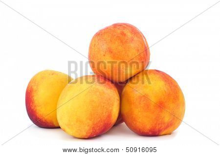 a pile of appetizing nectarines on a white background
