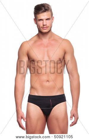 closeup of a young man wearing nothing but his underware, looking at the camera. isolated on white