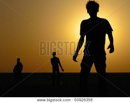Silhouette of Boys Playing in the Desert