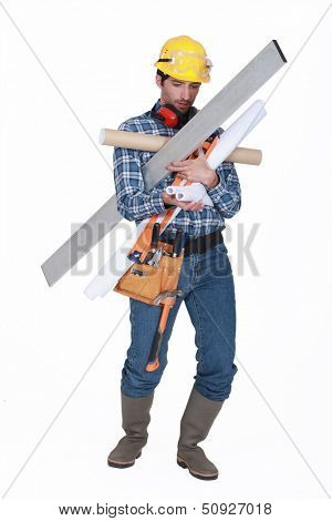 Builder struggling to carry equipment