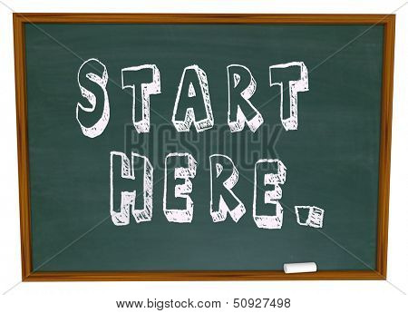 The words Start Here on a chalkboard in a classroom to illustrate the beginning of instruction, learning and education for a new skill or understanding