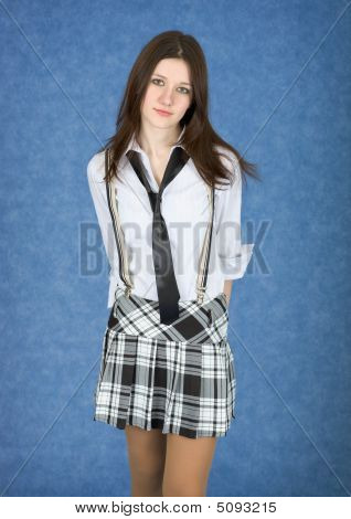 Girl In A Skirt On A Blue Background