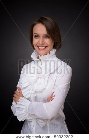Smiling woman in white shirt frill