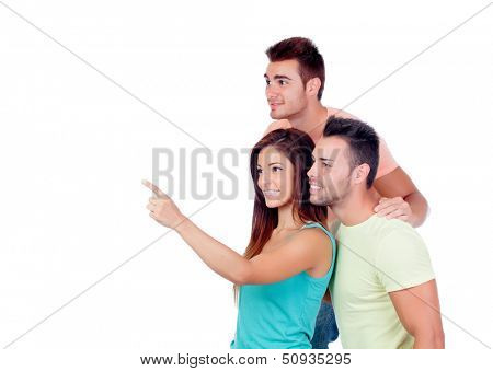 Pretty girl indicating something with two handsome boys isolated on a white background