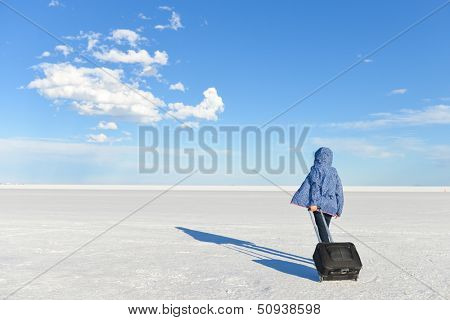 Girl in travel with a vast white salt flats background in Bonneville, Utah