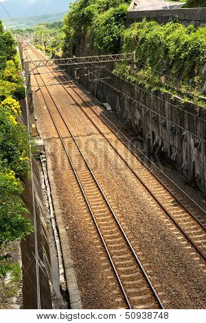 Railroad between meadow in Taiwan, Asia.