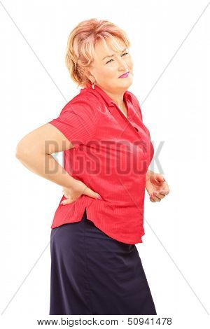Mature woman suffering from a back pain isolated on white background