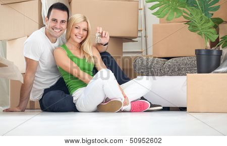 Portrait of happy couple with key of new home